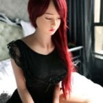 Real sex doll 140 cm yumi - With glorious long red hair eyes closed 2